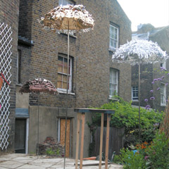 """Performance"" Flaca London, 2005, with Alice Chauchat, Christian Egger, Christian Mayer, Yves Mettler, Magta Tothova, Ruth Weismann, Alexander Wolff, Untitled, foil on umbrellas, hight: 200 cm, 250 cm, 300 cm, 2005"